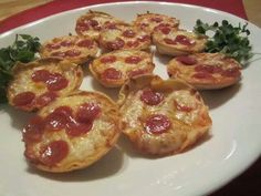Tortilla Pizza Bites 1 package of Tortillas Can of sauce 1 bag mozzarella 1 bag  pepperoni slices or topping of your choice Cook @ 400  Use a small glass or use the can from the sauce to cut 3 circles out of each tortilla. Lay circles in the bottom of a muffin pan. Put about 2 tablespoons of sauce on each tortilla round Top with shredded Mozzarella and pepperoni slices. Bake in oven for 12 minutes or until cheese is melted. let cool for a few minutes and use a fork to remove from pan.