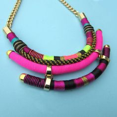 Multi layer necklace tribal inspired with a variarety of pink and dark rasperry…
