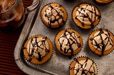 "Root Beer Float Cupcakes recipe...not sure what the ""root beer float dessert topper"" is....is that just chocolate syrup drizzled over them?"