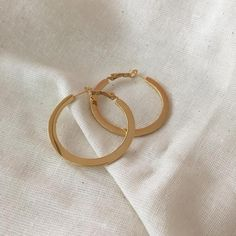 A flat take on the basic gold hoops earring, 40mm diameter - The Hexad Jewelry