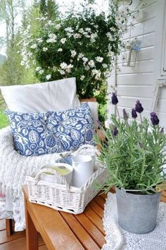 White wicker, lavender in a galvanized bucket, hanging plant (bacopa?)