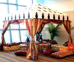 Non traditional seating at a #moroccan themed event will put guests in a comfortable setting