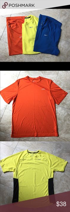 Bundle Of 3 Men's Dri-fit shirts This is a bundle of 2 Nike dri-fit running shirts and one Champion dri-fit shirt.  Orange-is the Champion running shirt and it's in excellent condition.  Blue- is a Nike dri-fit running shirt and it's in excellent condition as well.  Yellow- Nike dri-fit running shirt has a small stain and small snag on the front. Smoke free home. Nike Shirts Tees - Short Sleeve