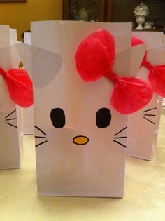 Hello Kitty Party Bags - these would be so easy to make and I could even buy other colors of bags for a few different characters.
