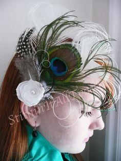 Notoria - White and Multi colored Peacock Feathers on an alligator clip by stitchingitalltogether