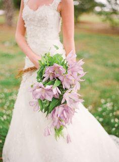 gorgeous purple clematis cascade bouquet