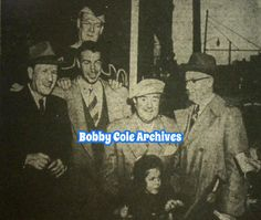 "Abbott and Costello and Joe DiMaggio, with Chris Costello and former Paterson Mayor Lester Titus, and the Giant from ""Jack in the Beanstalk"" at city hall prior to the premier of the movie at the Fabian Theater in 1952"