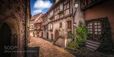 Eguisheim http://ift.tt/21gGzoB FranceStreetAlsaceEguisheimCobblestonesHalf-timbered houses