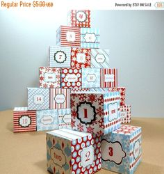 *** BACK TO SCHOOL SALE! 40% off all items in store until September 20, 2016. Discount has been applied to price. (Please note that coupon codes are disabled for the duration of the sale.) ***  Delight your child this December with treats and toys snugly tucked inside these bright and festive Advent Calendar boxes!  All you need is a pair of scissors, white card stock, a color printer, a glue stick, and your creativity & imagination to fill them up. (Tools to pre-score the fold lines are…