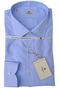 Luigi Borrelli shirt, imported straight from Borrelli in Italy, pointed collar, mother-of-pearl button, hand stitched armholes... white blue grid design.