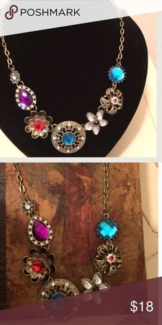 JUST LISTED: NWT Statement Necklace JUST LISTED: Statement Necklace   Color: Gold, red, blue, purple, clear, black,   CONDITION: New With Tags   ❌Trades❌  ⚡️I ship lightening fast⚡️  🎉Discounts with bundles 🎉 Little Sparkle Boutique Jewelry Necklaces