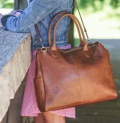 The perfect alternative to the traditional diaper bag - Oemi Baby 100% leather diaper bags! Find at babycubby.com