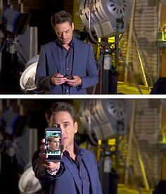 Robert Downey Jr. promotes the new HTC One M8 smartphone with his phone buddy.  (LOL!)