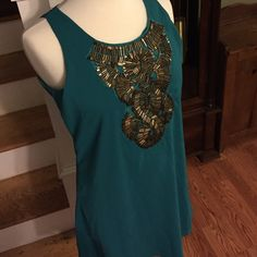 Beautiful embellished dress Gorgeous turquoise dress with beautiful embellishment on front - worn once Francesca's Collections Dresses Midi