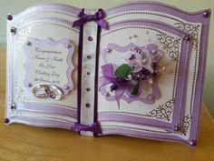Purple themed BOOKATRIX wedding card.