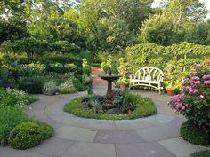 Beautiful circular bluestone patio.