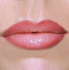 Permanent Makeup Lips...enduring, natural color. I might would consider this.