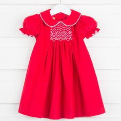 http://www.smockedauctions.com/center-smocked-geometric-dress-red-corduroy.html