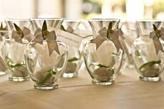 Mini glass vases with favors.