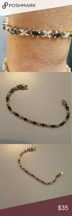 "925 sterling silver with sapphire gemstonesk Stunning 925 Sterling silver faceted Sapphire gemstones.  It has sterling silver ""x's"" I'm between stones. 7 inches long. Jewelry Bracelets"