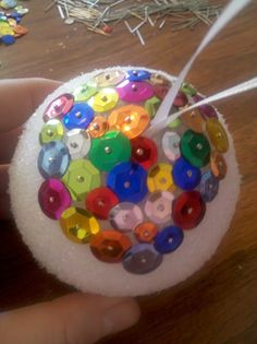 Christmas ornament or New Year's Eve Disco Ball- Party Favor.  (Kid Friendly) Craft, I made one of these in elementary school (very easy for kids, straight pins are involved, so be mindful of child's ability)