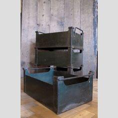 A vintage steel factory turret bin