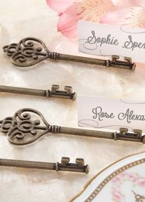 """Vintage charm meets utterly unique in this Victorian key that holds place cards and photos. A fabulous favor is the key to a memorable thank-you gift and this intricately crafted key is designed to unlock memories! Features and facts: Antique-gold-finish resin Victorian-style key with slit for place card. Key measures approximately 3 1/4"""" h x 1 1/4"""" w. Coordinated place cards included. Sold as a set of 4. View Alternate Link"""