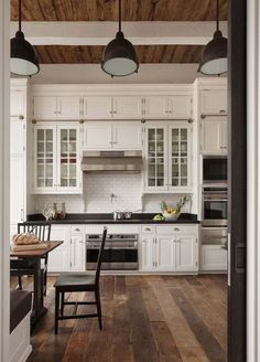 Glass cabinets with solid cabinet doors on top. Love the floors