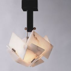 A pendant light designed by Pierre Chareau (Galerie MCDE)
