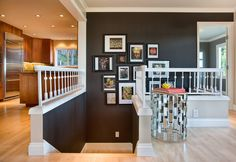 Love the bannisters and the very dark wall color.