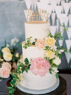 Buttercream Wedding Cake With Peonies and Ranunculus | http://trib.al/sMIQs1I