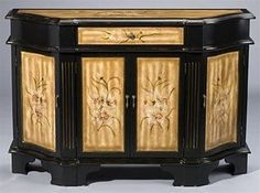 Black and Tan Sideboard Console 48993. h1Black and Tan Sideboard Console 48993_h1This phenomenal Black and Tan Sideboard Console 48993 features a black finish, tan panels on each of four doors, one drawer and on the top, with delightful botanical designs.. See More Sideboards at http://www.ourgreatshop.com/Sideboards-C669.aspx