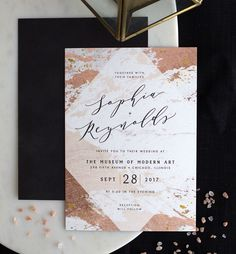 Modern abstract wedding invitation in rose gold