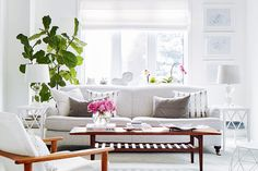 A crisp white home accented with charming thrift shop finds | Style at Home