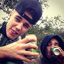 Justin Bieber enjoys a cold one in South Africa.
