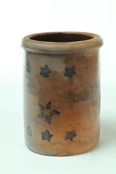 "STONEWARE CROCK OR CANNING JAR.  American, mid 19th century. Stenciled cobalt stars. 9.5""h."