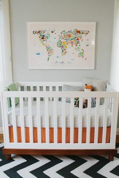 Fun bright gender neutral nursery. In love with the world map made of animals.