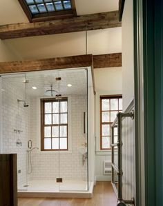 Shower in barn conversion has small sink and 3 types of showerheads; Heritage Restorations
