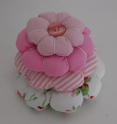 cute pincushion. Maybe two layers would be enough.