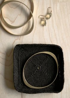 Crocheted Jewelry Dishes | The Purl Bee - I'd make it with thicker and more shiny yarn.