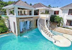 This house has it all; a sunny pool, sliding stairs and a view with rain.