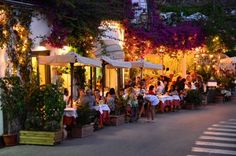 Dining at restaurants and sidewalk cafes on street in Positano, one of the most famous towns along the Amalfi Coast.