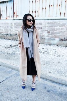 "fashion-clue: ""justthedesign: ""A cashmere scarf is the ultimate accessory to a maxi coat. Try paler colours on yours when wearing a beige coat, like the one seen here worn by Juley Le. Coat: Forever..."