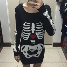 Betsey Johnson Skeleton Sweater Dress  Twice used Betsey Johnson sweater dress with a skeleton pattern. Excellent condition with no sign of wear. Very warm and cute sweater! ✨ Betsey Johnson Sweaters