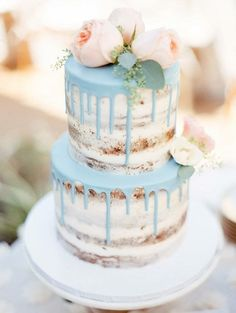 naked cake with dripped icing and flowers