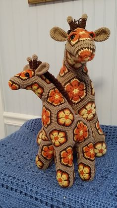 "I think I made enough ""test"" motifs to actually make a whole giraffe, but the effort was worth the time and I finally figured out the color combos I wanted to use and settled on a slightly altered..."