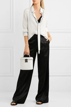 White and black crepe de chine Button fastenings through front 70% viscose, 30% silk Dry clean Imported