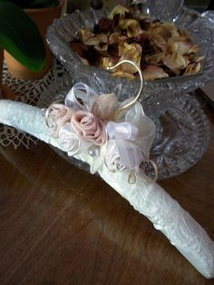 Bridal hanger soft peach apricot satin hand twist rosettes vintage inspired. Find it here.....   http://www.etsy.com/listing/62786451/bridal-hanger-soft-peach-apricot-satin?ref=sr_gallery_21_search_query=bridal+hangers_ref=market_search_type=all_view_type=gallery