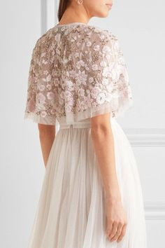 Needle & Thread's cape is embroidered with pink and ivory flowers and embellished with scores of iridescent beads. A beautiful option for brides, it's cut from two layers of wispy tulle and trimmed with delicate lace at the neckline. Layer yours over a strapless gown.