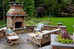Outdoor stone patio and fireplace